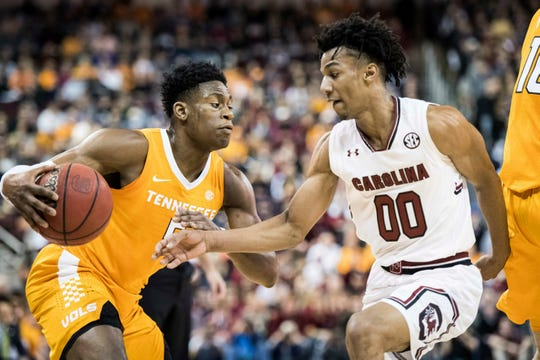 Tennessee guard Admiral Schofield, left, drives to the hoop against South Carolina guard A.J. Lawson (00) during the first half of an NCAA college basketball game Tuesday, Jan. 29, 2019, in Columbia, S.C.
