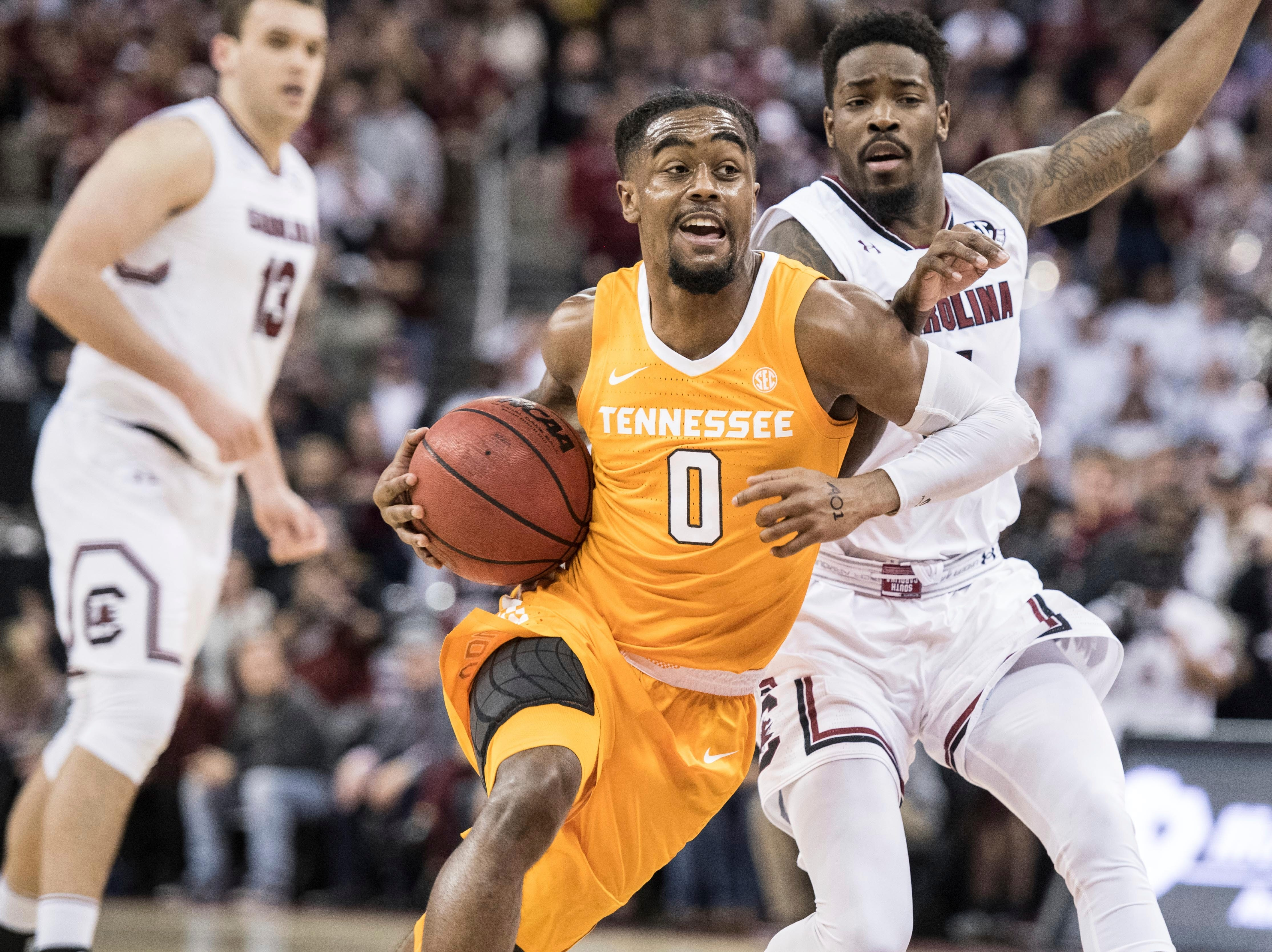 Tennessee guard Jordan Bone (0) drives to the hoop against South Carolina guard Tre Campbell during the first half of an NCAA college basketball game Tuesday, Jan. 29, 2019, in Columbia, S.C. (AP Photo/Sean Rayford)
