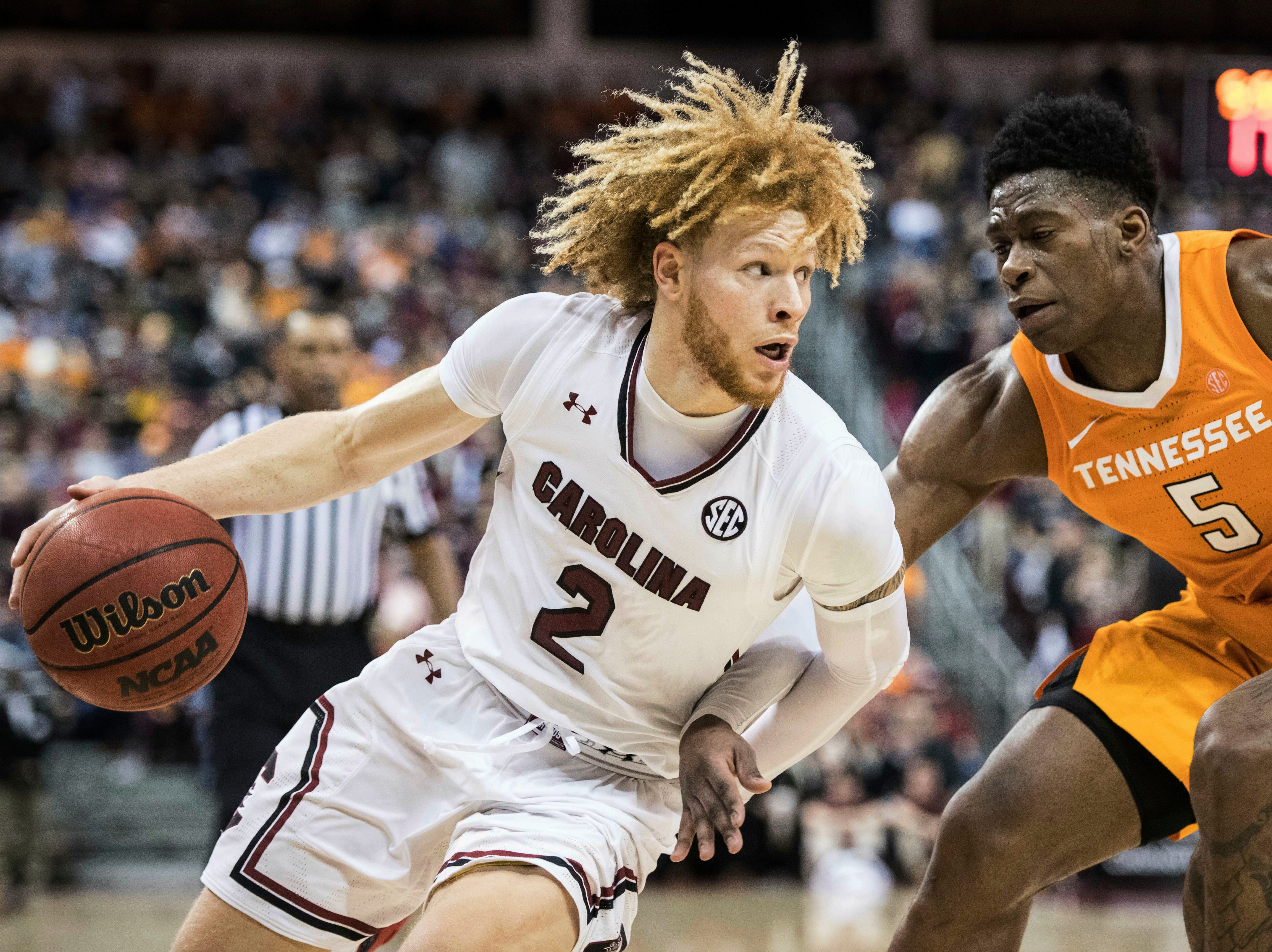 South Carolina guard Hassani Gravett (2) drives to the hoop against Tennessee guard Admiral Schofield (5) during the first half of an NCAA college basketball game Tuesday, Jan. 29, 2019, in Columbia, S.C. Tennessee defeated South Carolina 92-70.