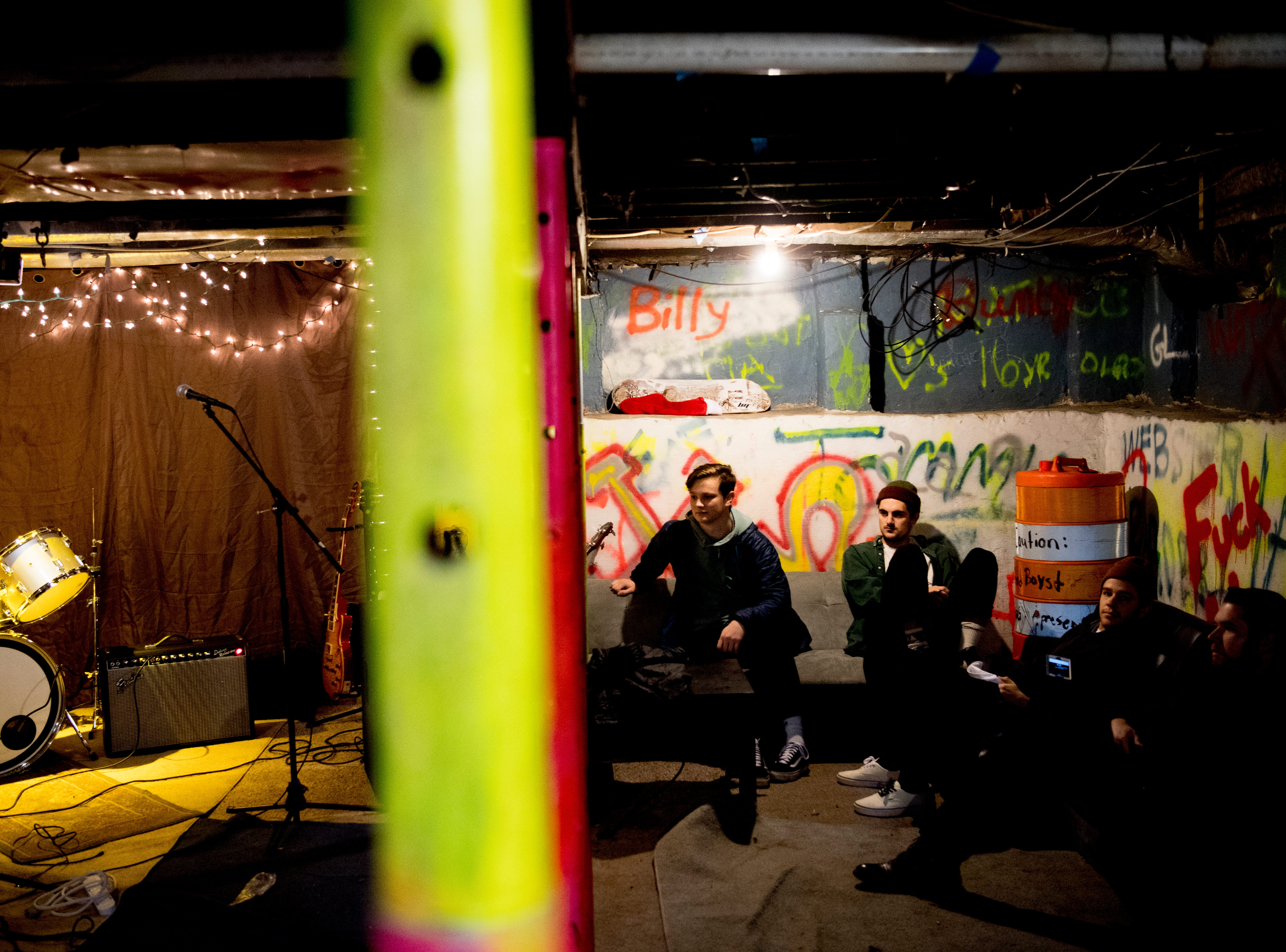 From left, Michael Burgard, Tyler Clark and Tyler Cage hang out in The Basement at 1706 Highland Ave. in Knoxville, Tennessee on Wednesday, January 30, 2019. The new venue is aiming to host local and national talent as well as arts and crafts.