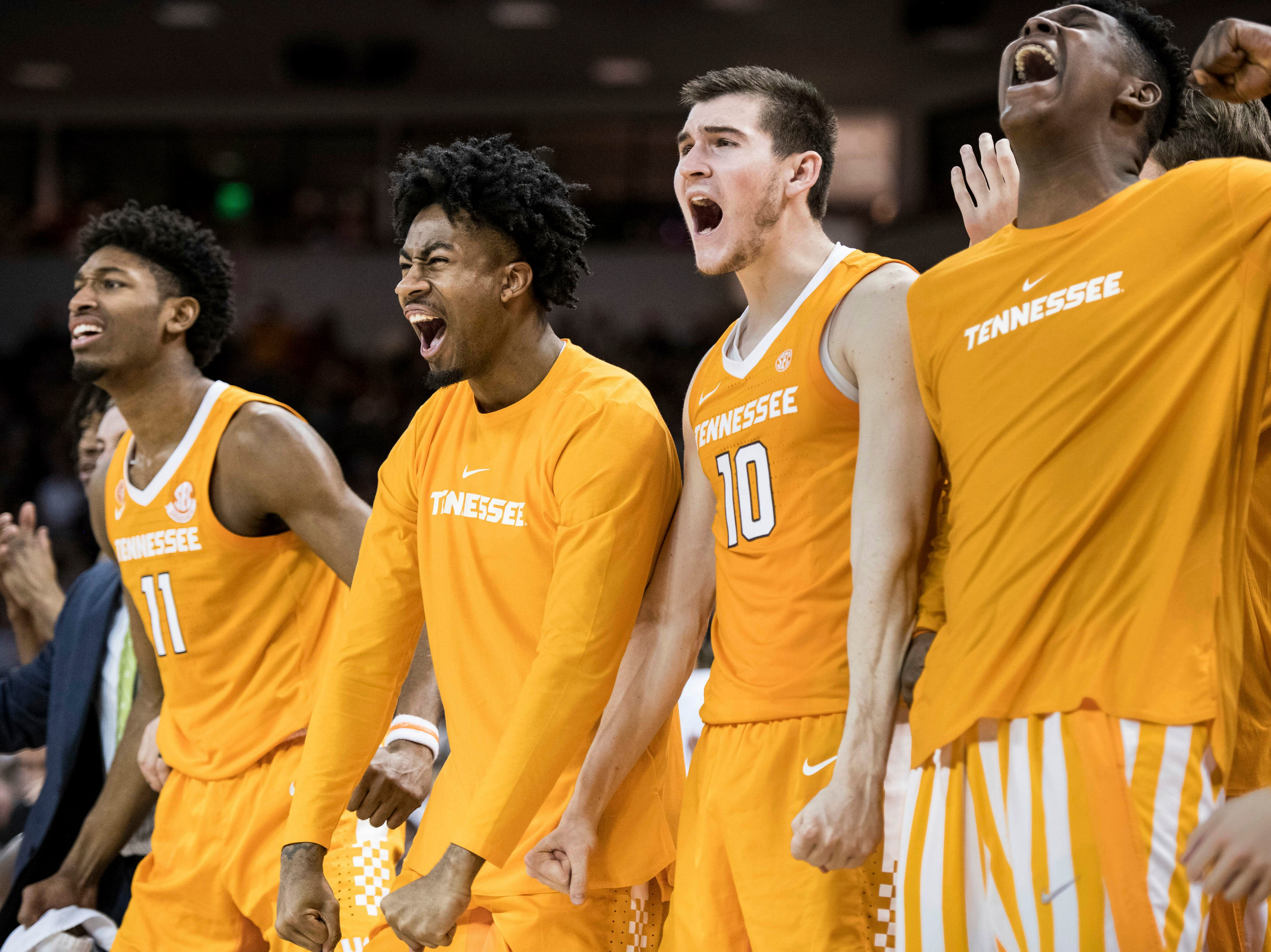 Tennessee forward John Fulkerson (10), Jordan Bowden and Kyle Alexander (11) celebrate a basket against South Carolina during the second half of an NCAA college basketball game Tuesday, Jan. 29, 2019, in Columbia, S.C. Tennessee defeated South Carolina 92-70.