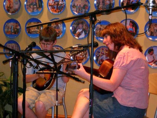 Sam Shadwell performs at WDVX studios with his teacher Sarah Pirkle in 2007.