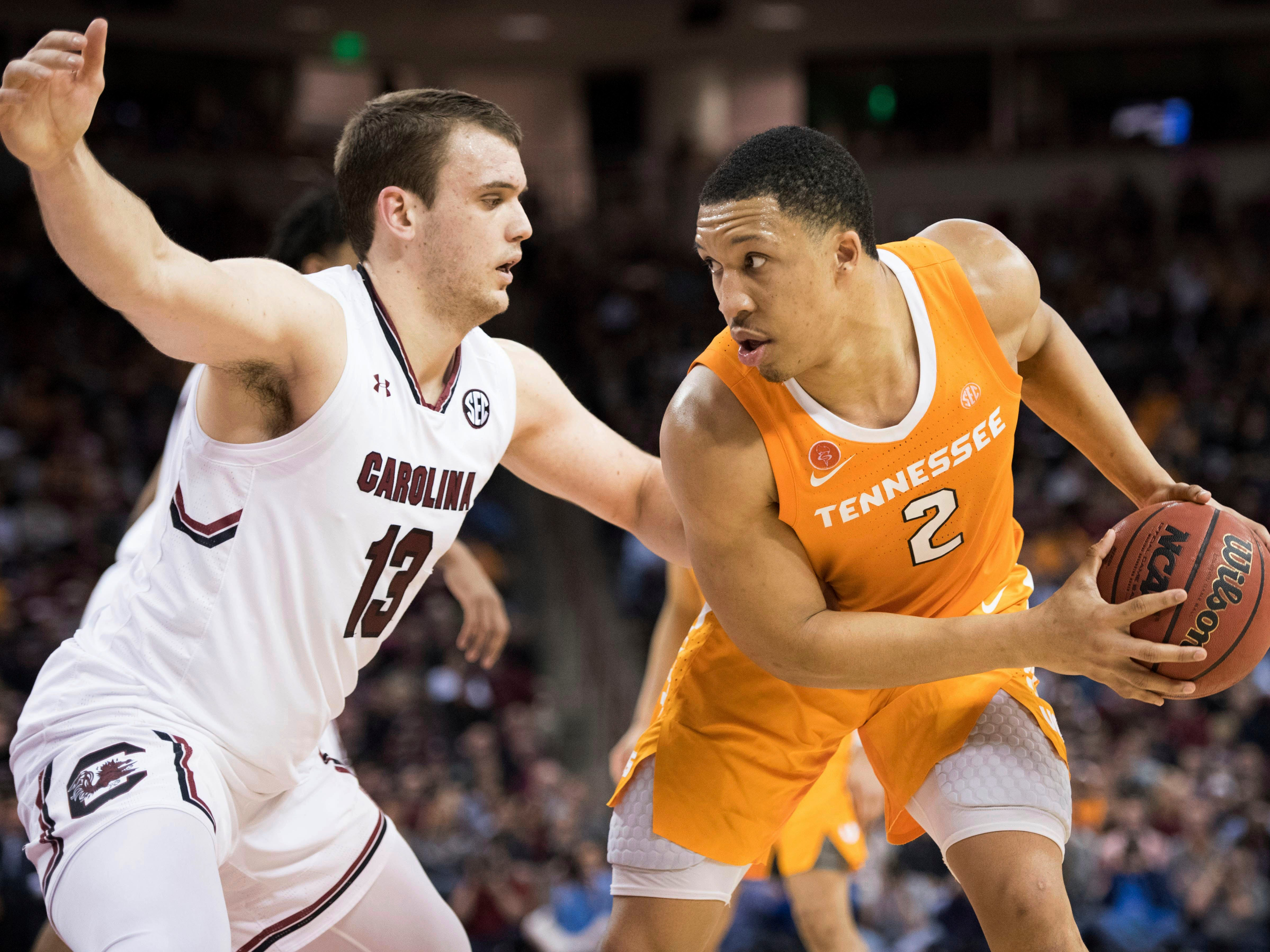 Tennessee forward Grant Williams (2) makes a move on South Carolina forward Felipe Haase (13) during the second half of an NCAA college basketball game Tuesday, Jan. 29, 2019, in Columbia, S.C. Tennessee defeated South Carolina 92-70.