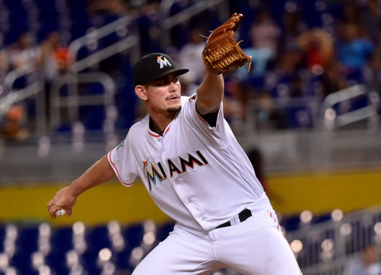 Miami Marlins relief pitcher Nick Wittgren (64) throws in the ninth inning against the Arizona Diamondbacks at Marlins Park on June 25, 2018.