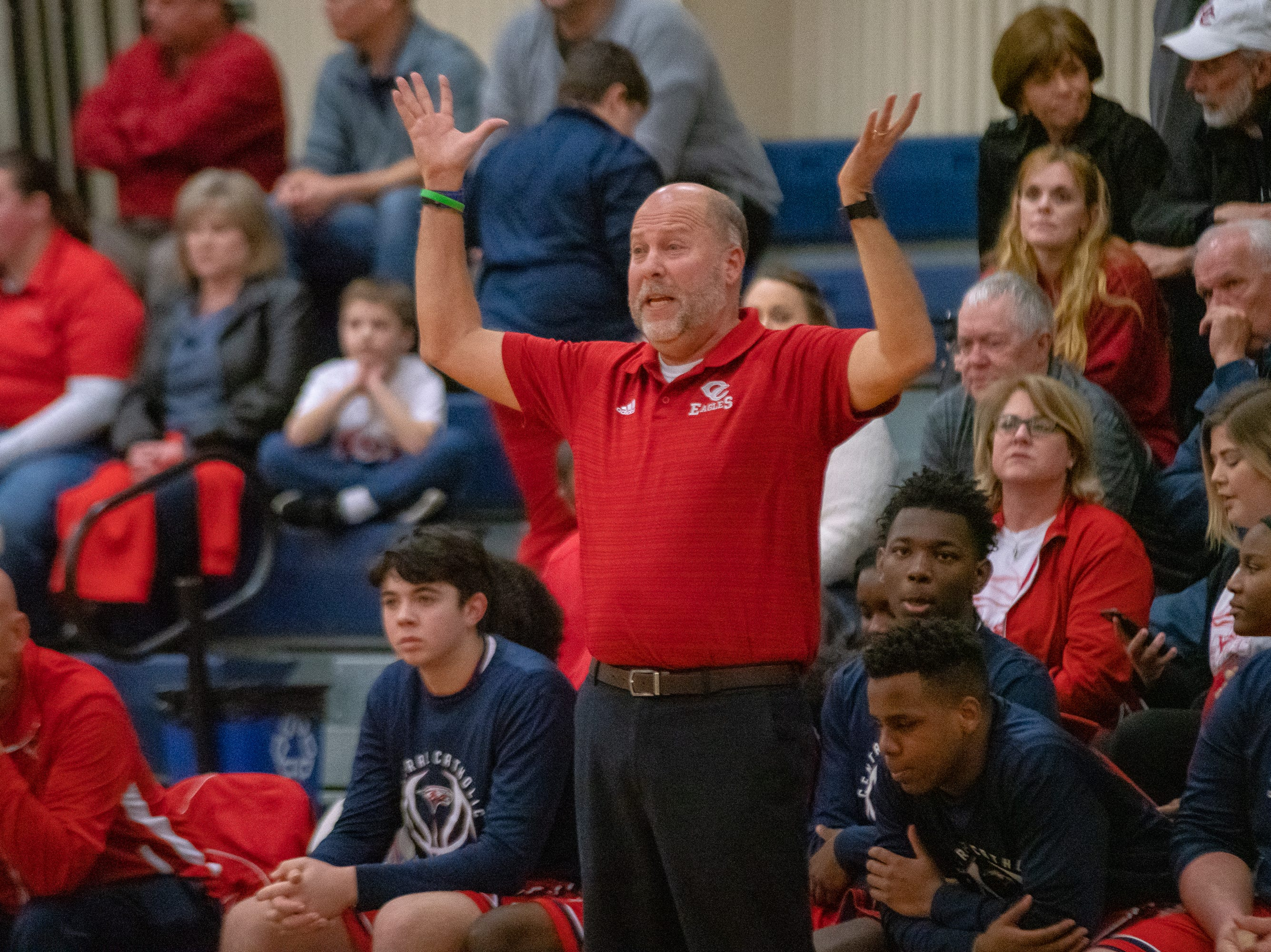 Central Catholic's head coach Larry Case II questions a call from the officials as the LCA Knights take on the Central Catholic Eagles on January 29, 2019.