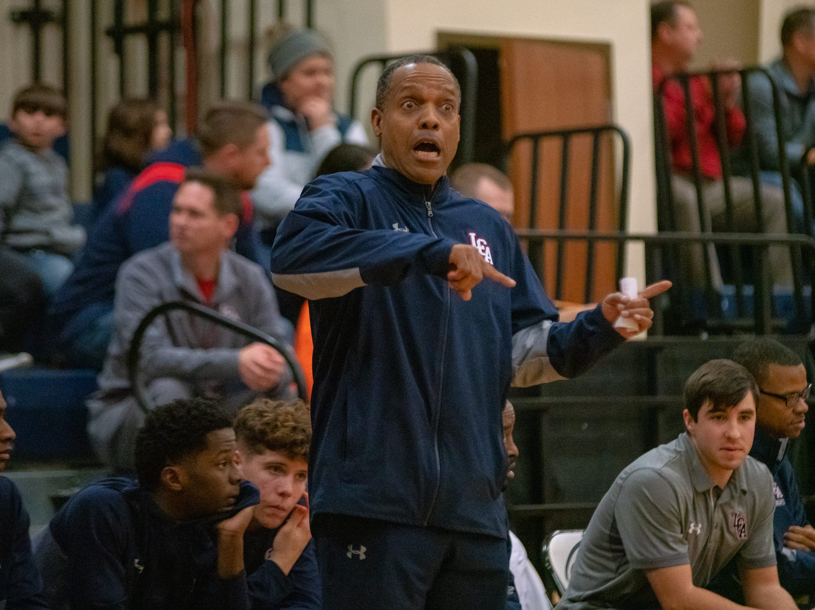 Lafayette Christian's head coach Byron Starks communicates with his players from the bench as the LCA Knights take on the Central Catholic Eagles on January 29, 2019.
