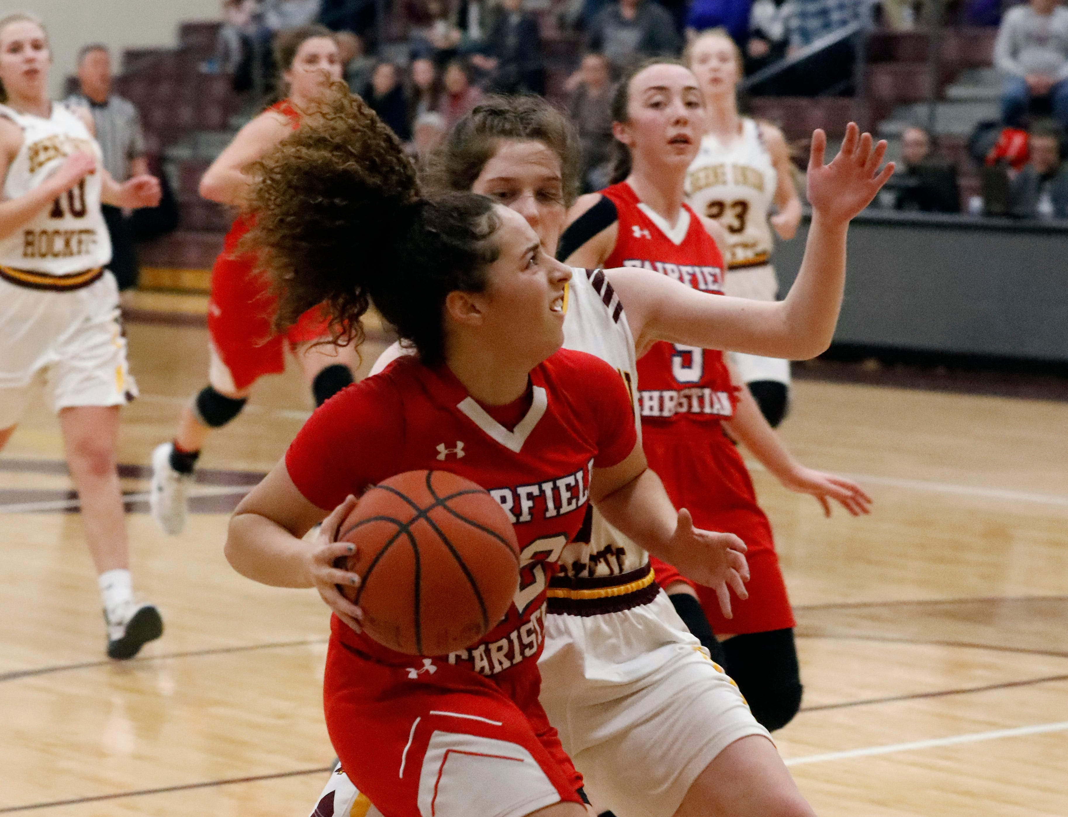 Fairfield Christian's Celeste Mershimer drives past Berne Union's Mya Staten during Tuesday night's game, Jan. 29, 2019, at Berne Union High School in Sugar Grove. The Knights defeated the Rockets 84-37.