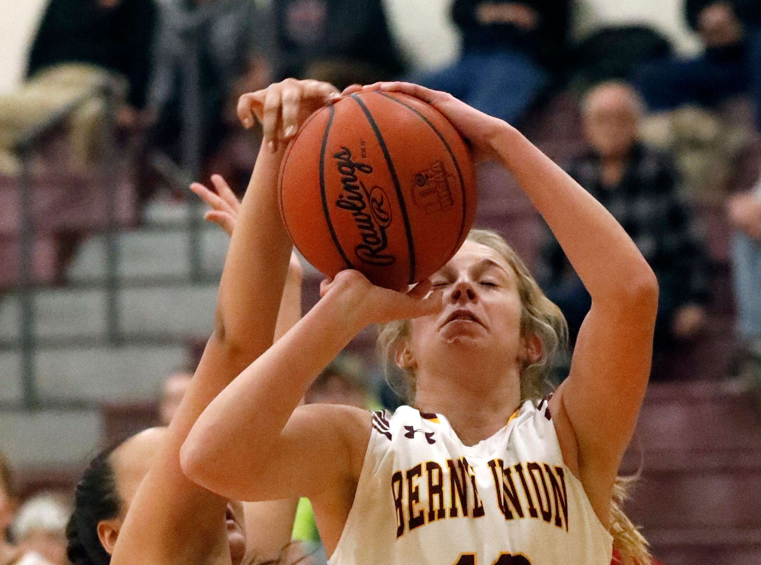 Fairfield Christian's Janae Grabans blocks the shot of Berne Union's Lauren Nemeth during Tuesday night's game, Jan. 29, 2019, at Berne Union High School in Sugar Grove. The Knights won the game 84-37.