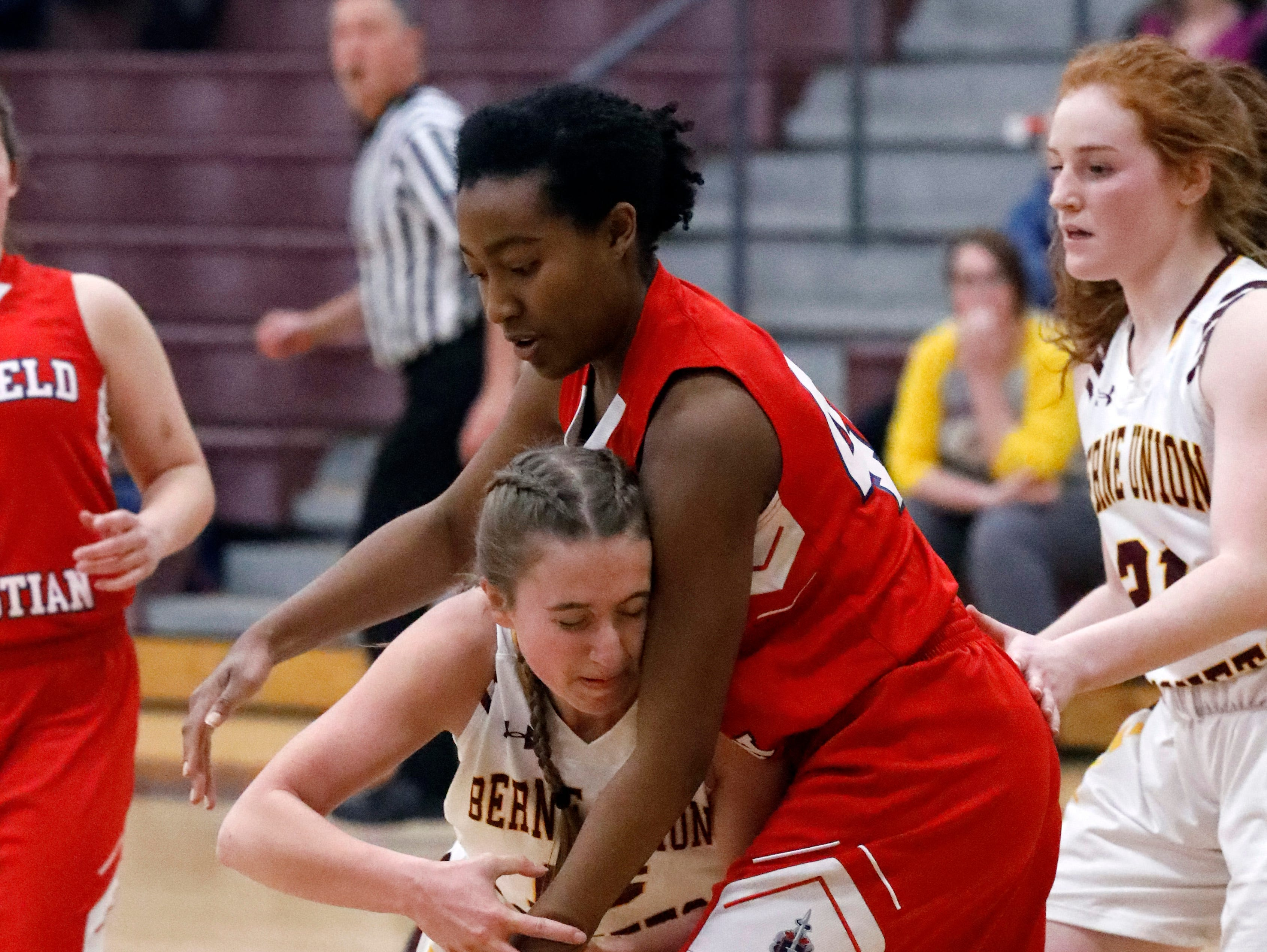 Berne Union's Emily Blevins collides with Fairfield Christian's Maame Adu Tuesday night, Jan. 29, 2019, at Berne Union High School in Sugar Grove. The Knights defeated the Rockets 84-37.