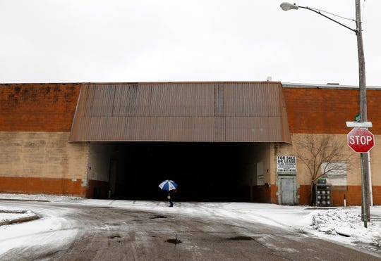 A person walks in front of the delivery dock of a warehouse Thursday morning, Jan. 24, 2019, on Fulkerson Avenue in Lancaster. The warehouse at Fulkerson Avenue and East Walnut Street and one next door at East Chestnust Street and Fulkerson Avenue were recently purcharsed by Shared Options. The company hopes to move other manufacturing companies into the spaces.