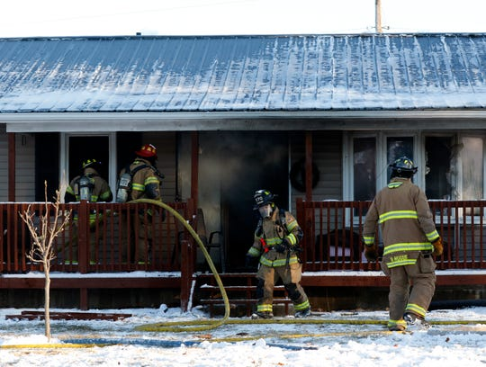 Fire destroyed a home, garage and several vehicles Wednesday morning, Jan. 30, 2019, in Rushcreek Township.  Bremen-Rushcreek Township Fire Chief William Duvall said the fire started in the home's garage, burning it to the ground, and spreading into the home itself. No one was injured in the fire.