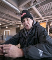 David Walker, shown Wednesday, Jan. 30, 2019, is among those who are served by churches like Brighton's 2|42 Community Church and volunteers from a number of churches in the area that provide them a place to stay overnight as well as during the daytime in the winter months.