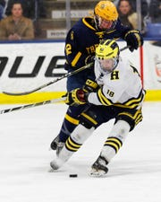 Brenden Tulpa (18) and his Hartland hockey teammates will face Trenton in a state championship game rematch Friday night.