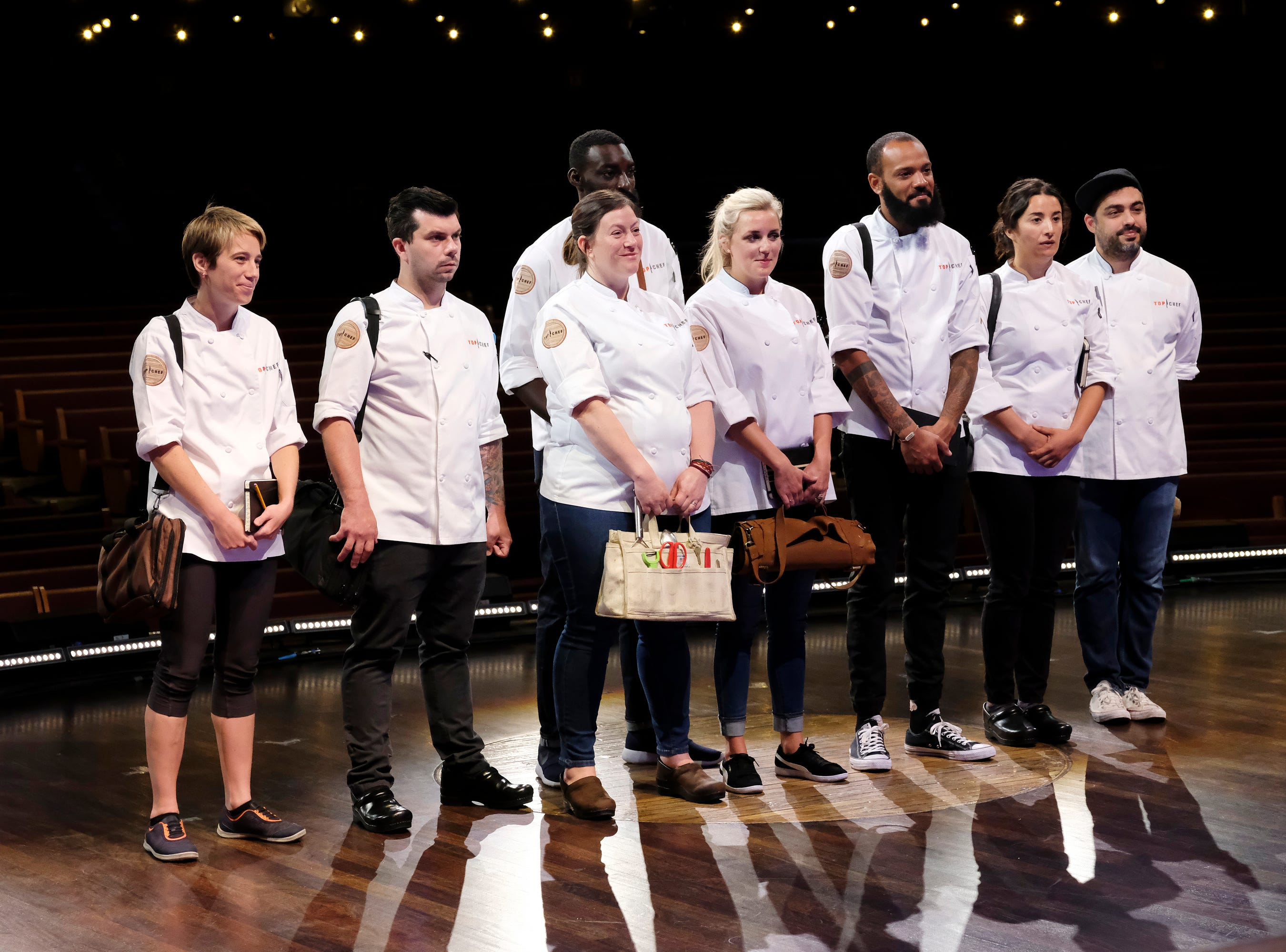 (Left to right) Adrienne Wright, Eddie Konrad, Sara Bradley, Eric Adjepong, Kelsey Barnard, Justin Sutherland, Michelle Minori and David Viana on episode 9 of Bravo's 'Top Chef: Kentucky' season.