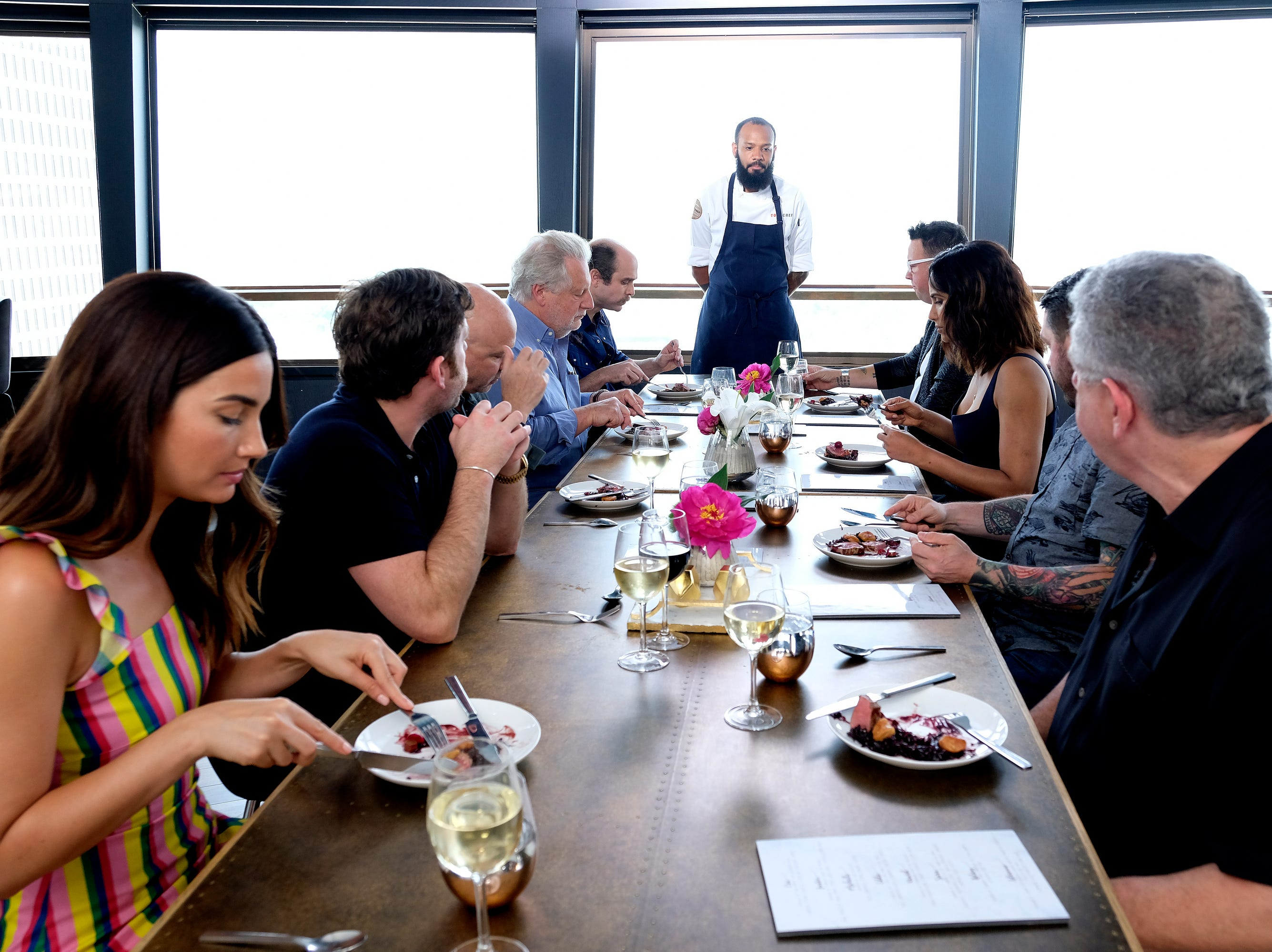 (Left to right): Model Lily Aldridge and  chef Jonathan Waxman, among others, listen to contestant  Justin Sutherland describe his dish on episode 9 of Bravo's 'Top Chef: Kentucky' season.