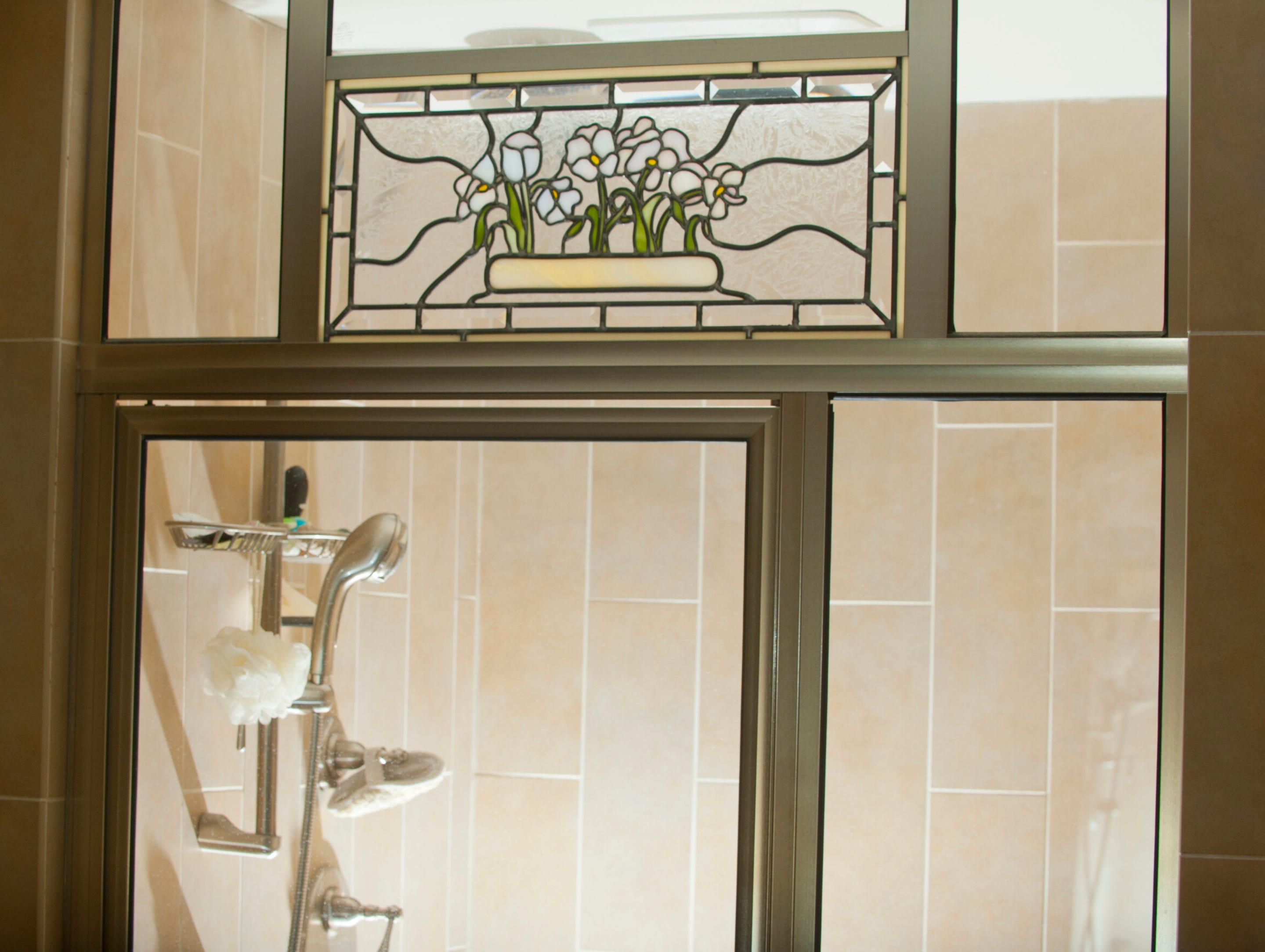 The Deeb's master bathroom is decorated with this stained glass window made by Carol Deeb's cousin, Cheryl Sexton.