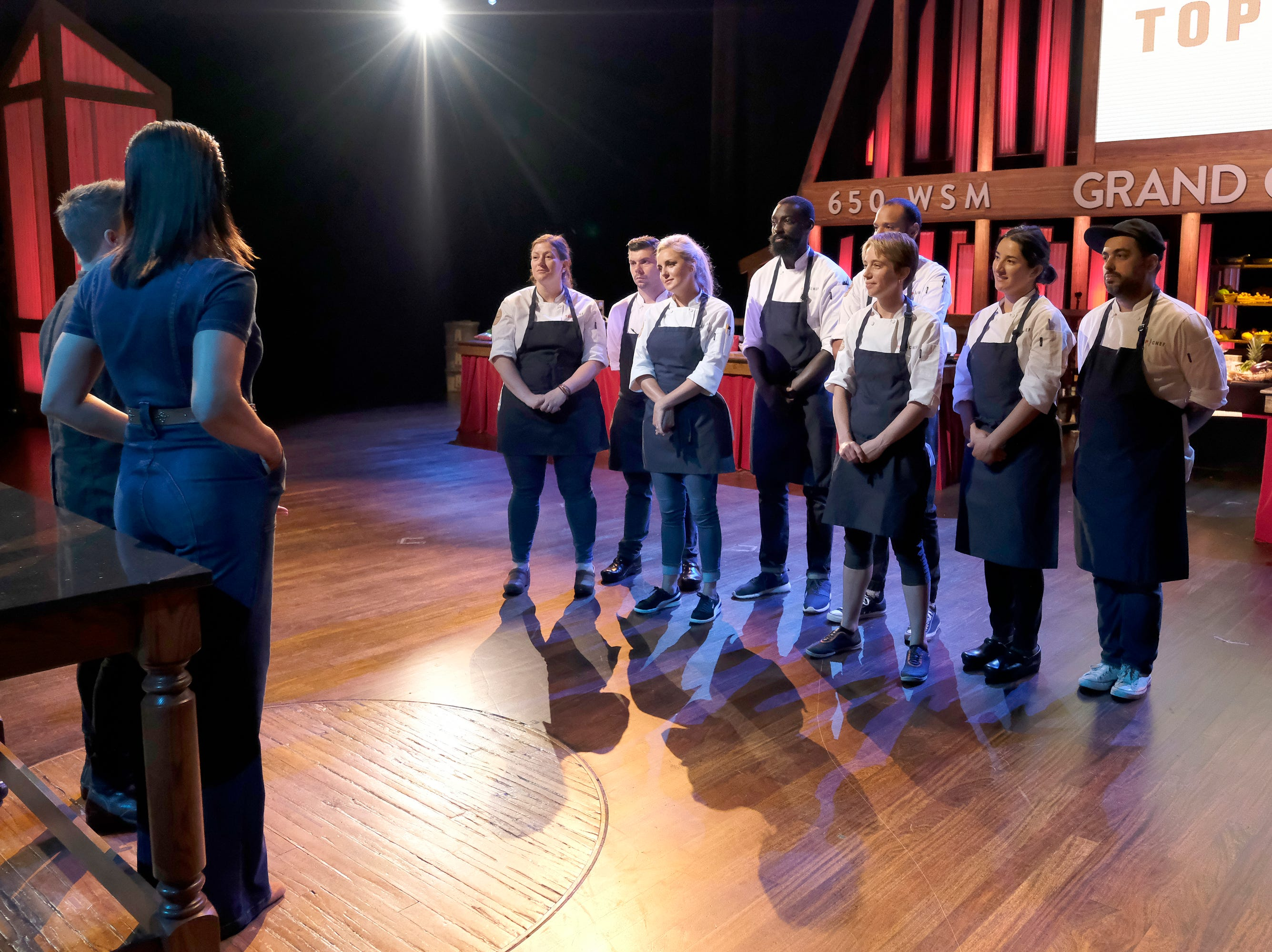 (Left to right): Contestants Sara Bradley, Eddie Konrad, Kelsey Barnard, Eric Adjepong, Adrienne Wright, Michelle Minori and David Viana at the Grand Ole Opry on episode 9 of Bravo's 'Top Chef: Kentucky' season.