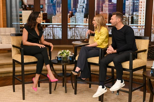 """Kelly Ripa and Ryan Seacrest talk with Padma Lakshmi during the production of """"Live with Kelly and Ryan"""" in New York on Tuesday, Jan. 22, 2019."""