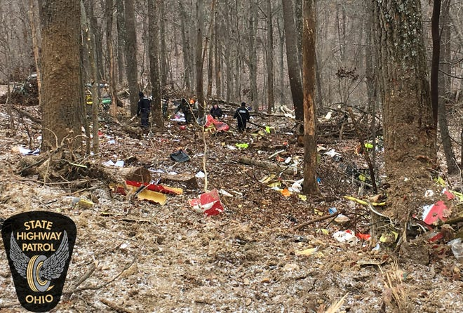 In this photo provided by the Ohio State Highway Patrol, authorities survey the scene of wreckage where a medical helicopter crashed in a remote wooded area in Brown Township, Ohio, on its way to pick up a patient, Tuesday, Jan. 29, 2019. There had been no reports of anyone else injured in the crash. No names were released immediately. A few crew members were all killed in the crash, authorities said.