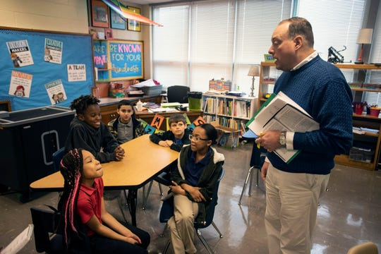Gilmore Lane Elementary principal Samuel Cowan briefs some of his students about the possible closing of the school.