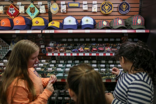 From left, Amanda Dewey, Katie Wetzel and Caroline Hughes, look at badges they can earn as Boy Scouts in the Louisville Scout Shop at the Lincoln Heritage Council. They will be a part of the new Troop 30GT. Beginning in February, The Boy Scouts of America will accept girls into the program, now to be called Scouts BSA.