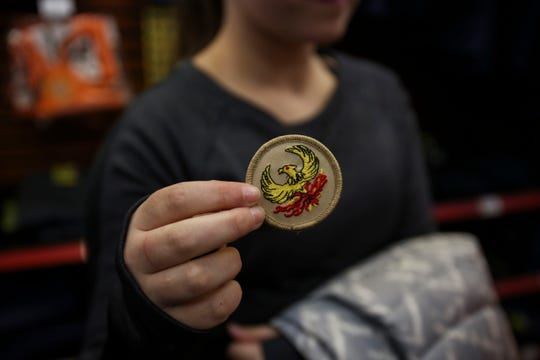 Katie Wetzel holds a badge her new troop chose as their patrol badge in the Louisville Scout Shop at Lincoln Heritage Council.