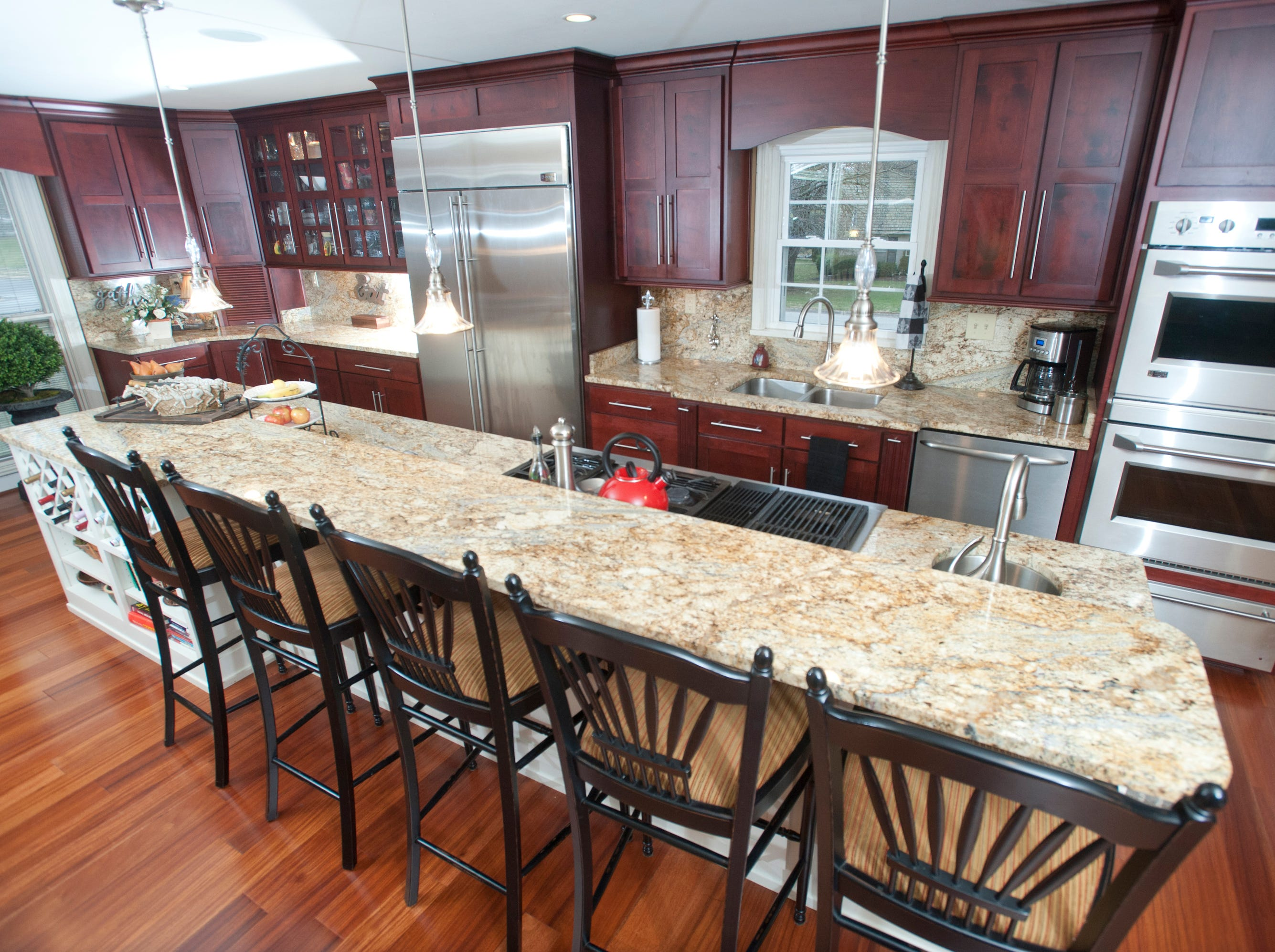 The Deebs combined the home's kitchen and dining room to make a new spacious kitchen which boasts an island 13 feet long.