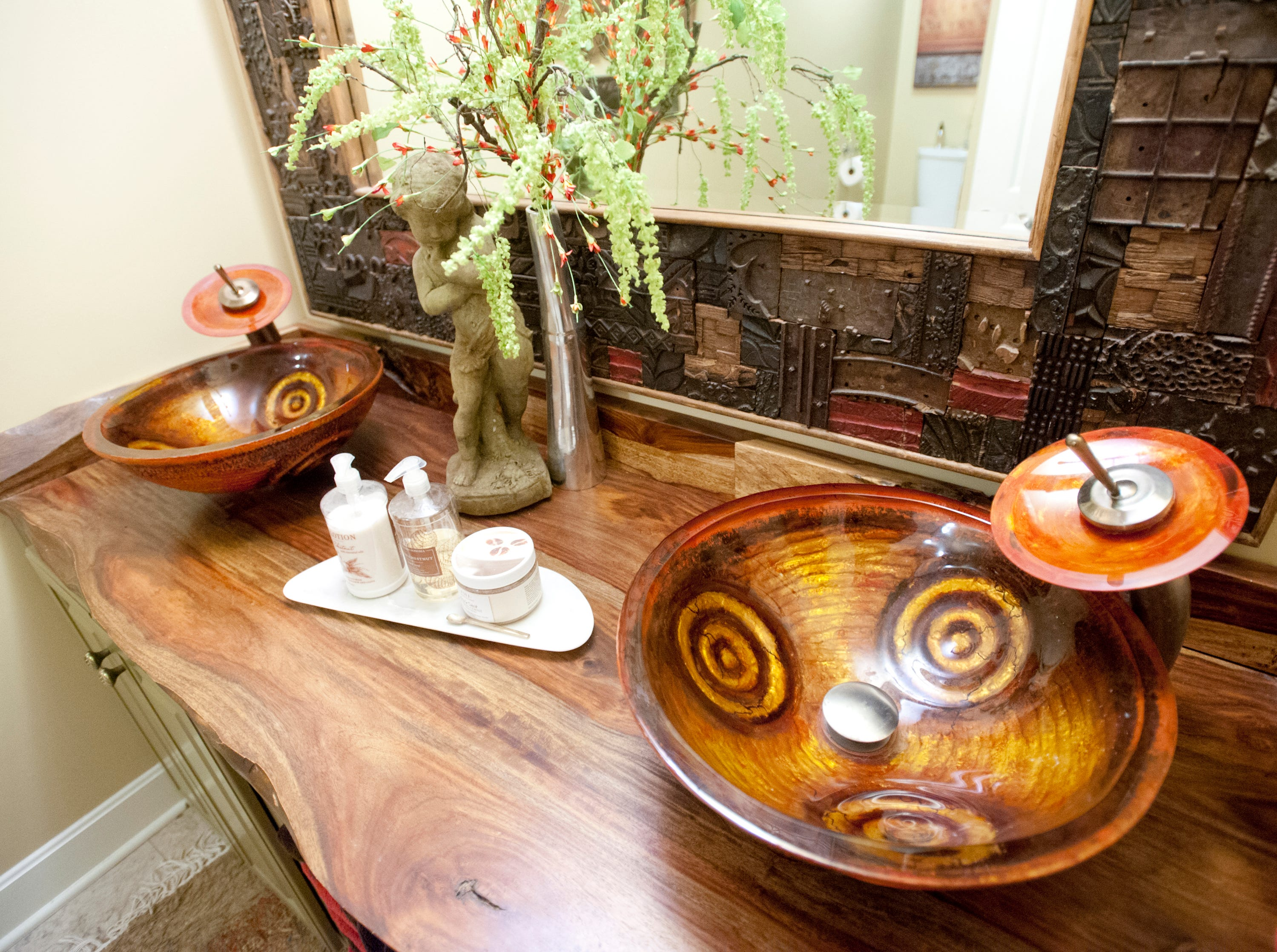 The guest bathroom features these dual decorative bowl sinks.