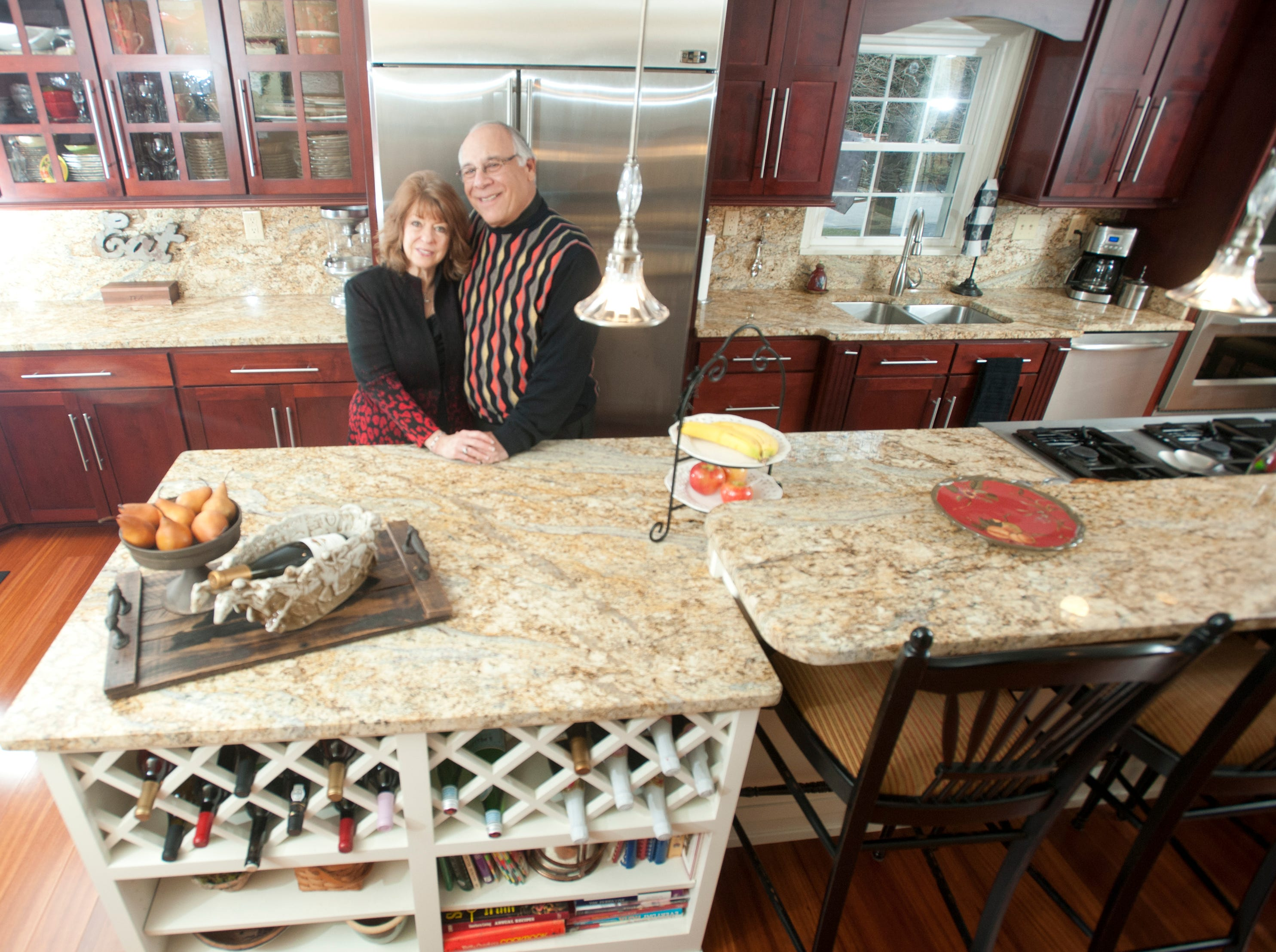 Carol and Mike Deeb in the kitchen of their recently renovated 1972 home in the Hurstbourne area of Louisville.