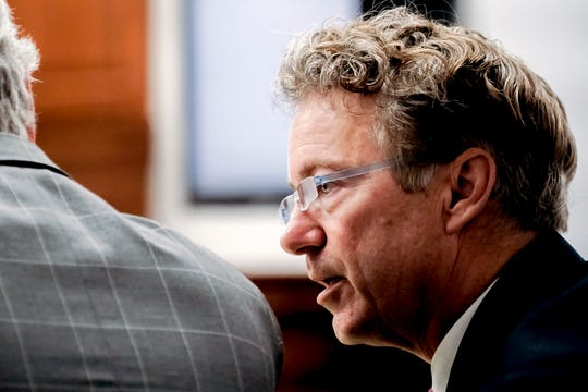 U.S. Sen. Rand Paul, R-Ky., talks with his attorney Tom Kerrick Tuesday, Jan. 29, 2019, during the second day of a civil trial involving Paul and his neighbor Rene Boucher in Warren Circuit Court in Bowling Green, Ky.