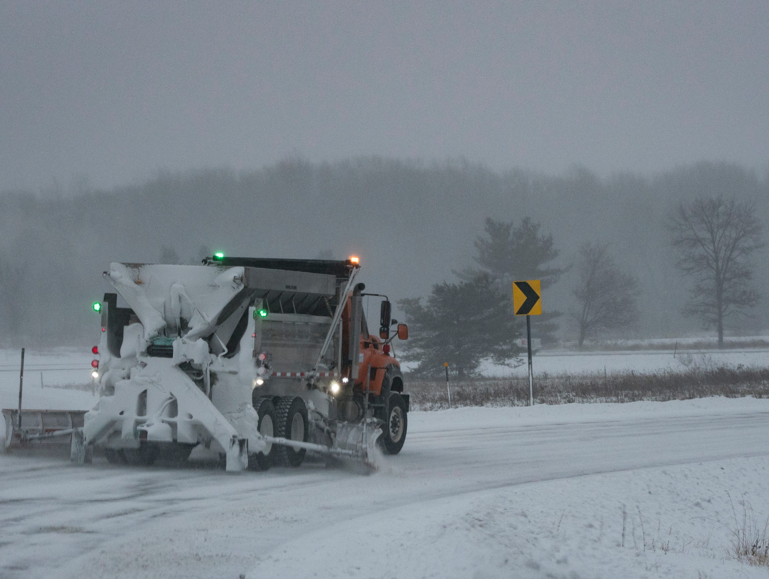 An Ingham County Road Commission truck tends  US-196 on ramp at Okemos Rd. Wednesday, morning, Jan. 30, 2019.[USA Today Network/Matthew Dae Smith/Lansing State Journal]