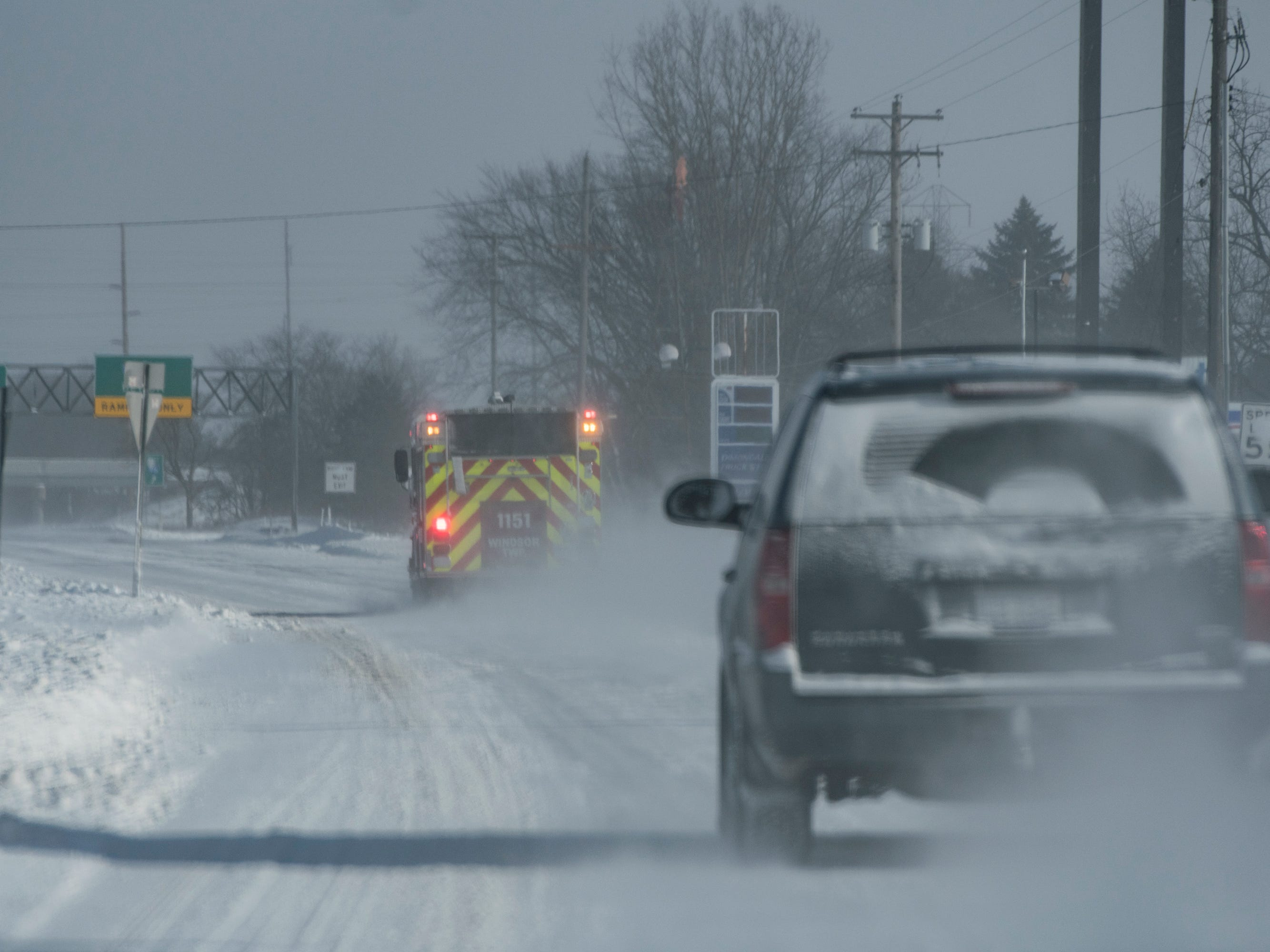 A firetruck heads east on Old Lansing Rd. near Dimondale,  Wednesday, Jan. 30, 2019.  [USA Today Network/Matthew Dae Smith/Lansing State Journal]