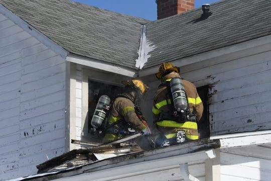 Mansfield firefighters battled a house fire Wednesday afternoon at the corner of Sixth Street and Sycamore Street.