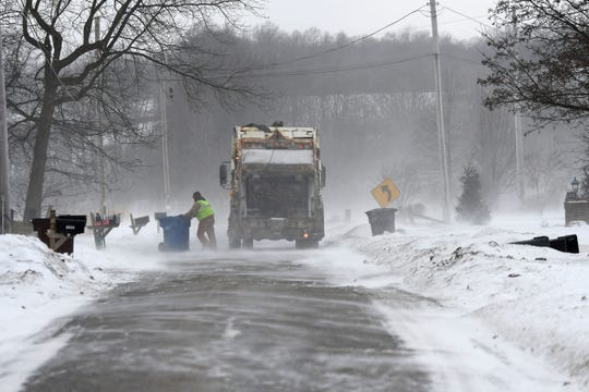 Trash collectors in Ashland worked their routes Wednesday morning despite the high winds and low temperatures.