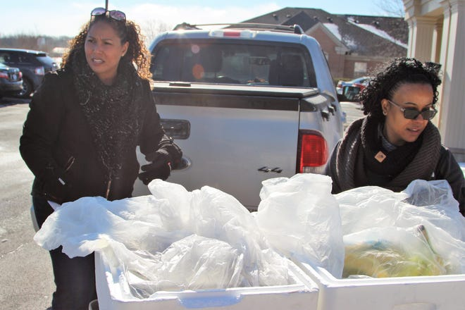 Jenny Cook and Mikki Capdeville brave the cold on Wednesday as they deliver meals to clients at the Primrose Retirement Community of Marion.