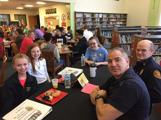 Firefighters lunch with students at a Leader in Me luncheon at McKinley Elementary.