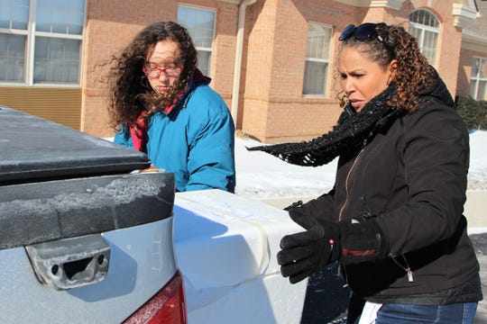 Jenny Cook delivered meals on behalf of the nonprofit LifeCare Alliance on Wednesday alongside her daughter India Willis, 12. Temperatures dropped to negative zero in the late morning as winds swept across the county.