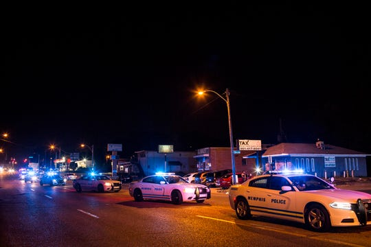 Memphis police officers are seen along Elvis Presley Boulevard on Sept. 19, 2018, after several people were arrested during a protest that blocked traffic near the site of the officer-involved shooting of Martavious Banks.