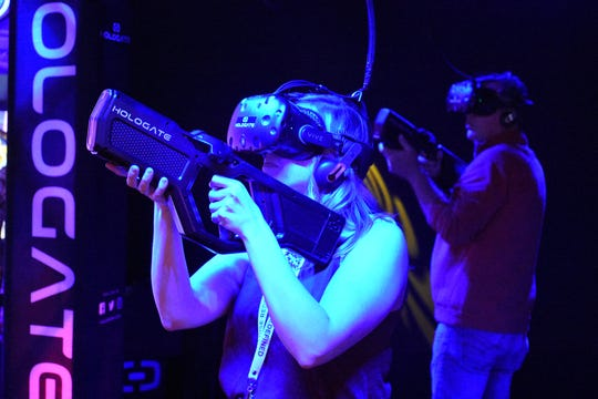 "Players shoot zombies in the Hologate virtual reality game. The JW Marriott hotel held an event they called ""Paradise Redefined"" Sunday and Monday to introduce their new adult-exclusive amenities to the local community."