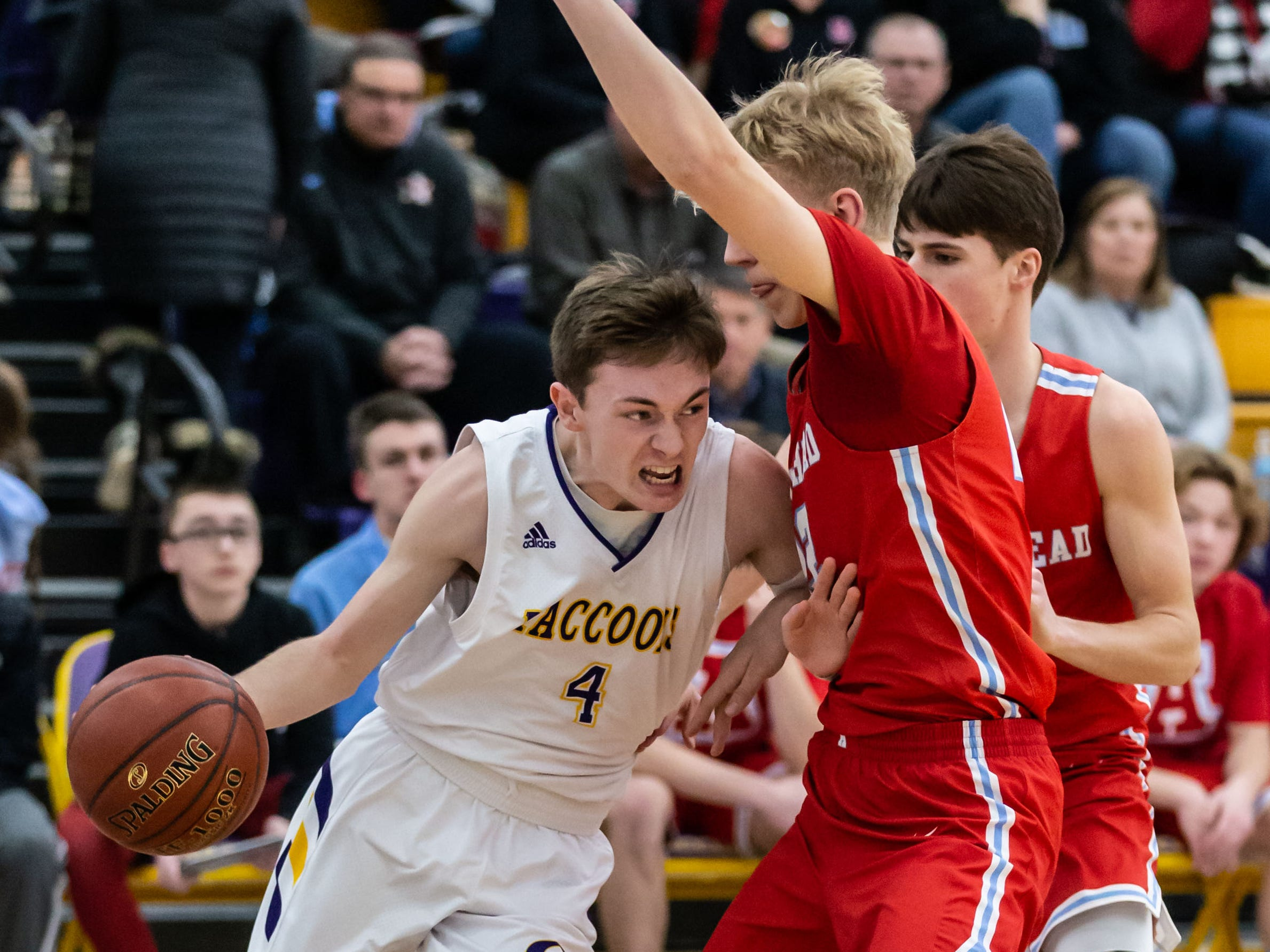 Oconomowoc's Connor Enright (4) battles past Arrowhead's Sam Hytinen (22) during the game at Oconomowoc on Tuesday, Jan. 29, 2019.