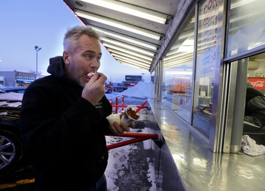 Pete Konzal of Wauwatosa braves subzero weather to have frozen custard Tuesday at Leon's Custard on South 27th Street. The store was not closing despite cold weather that dropped past 20 below zero this week.