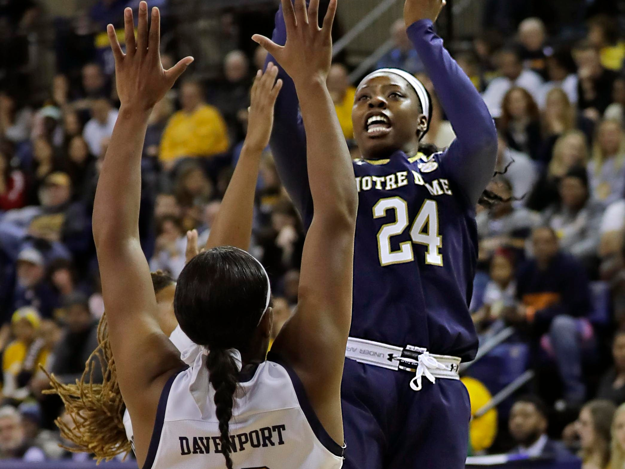 Notre Dame Fighting Irish guard Arike Ogunbowale (24) hits a jumper against Marquette Golden Eagles forward Erika Davenport (12) during the women's basketball  game  between Marquette and Notre Dame. Notre Dame, the the defending national champion, which won the game 87-63, is led by former DSHA star Arike Ogunbowale. MU is also a top-25 team expected to win the Big East.   MILWAUKEE JOURNAL SENTINEL/RICK WOOD ORG XMIT: 20097356A