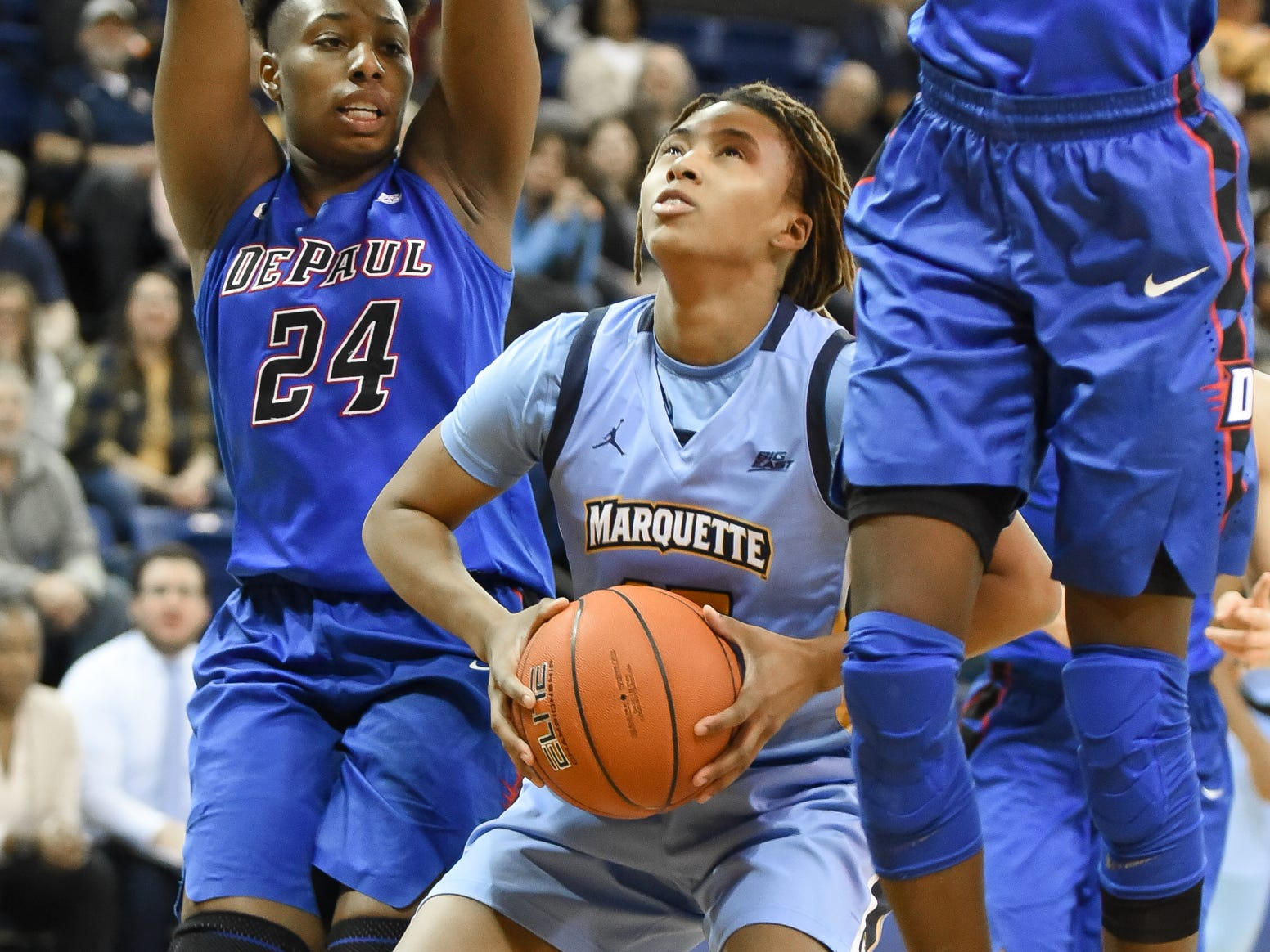 Marquette guard Amani Wilborn fakes DePaul guard Tanita Allen (24) and forward Chante Stonewall before going up for a shot in a Big East Conference women's basketball game Friday, January 4, 2019, at the Al McGuire Center on the Marquette campus.