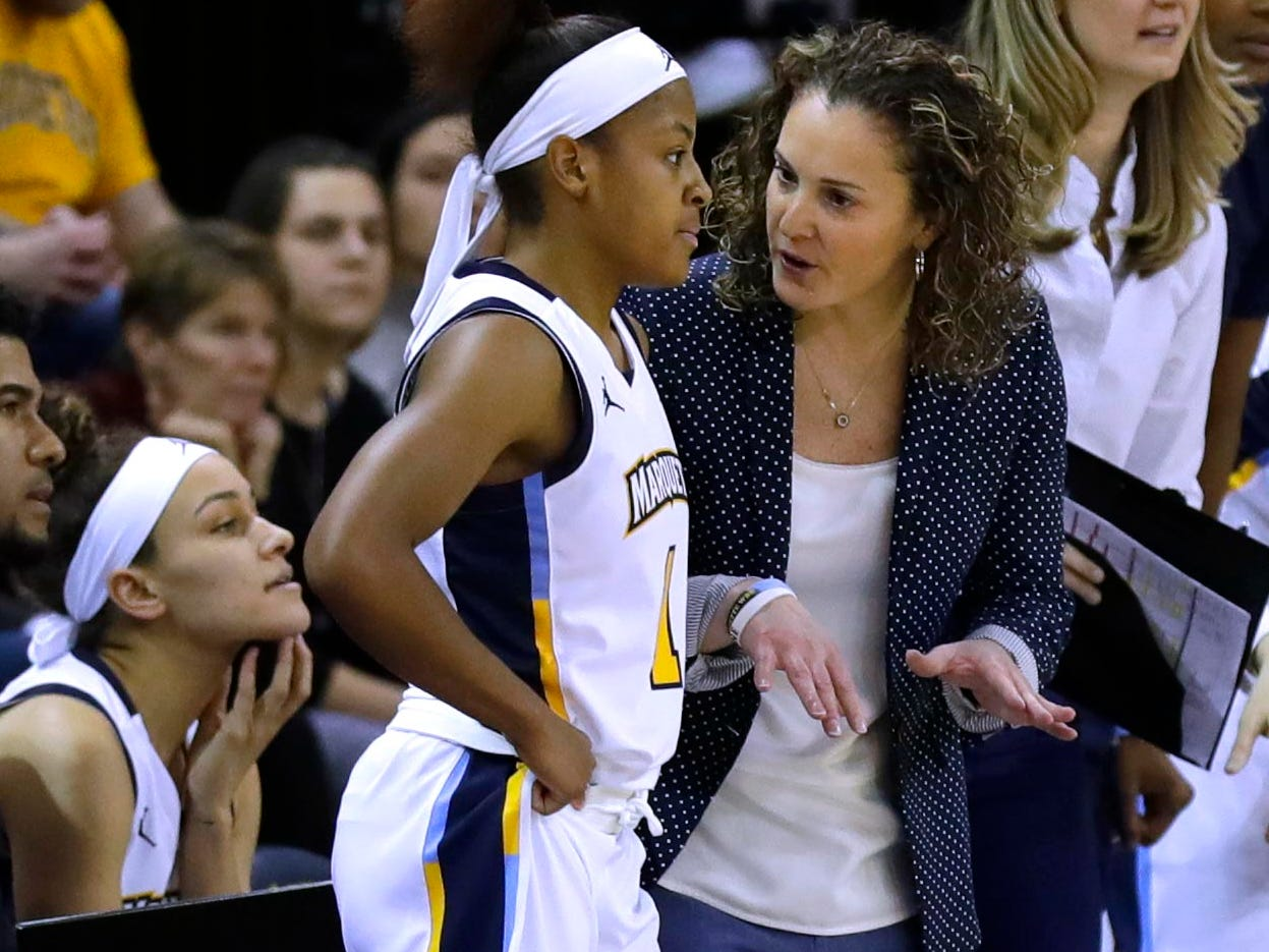 Marquette women basketball coach Carolyn Kieger talks with Marquette Golden Eagles guard Danielle King (1) during a time out during the women's basketball  game  between Marquette and Notre Dame. Notre Dame, the the defending national champion, which won the game 87-63, is led by former DSHA star Arike Ogunbowale. MU is also a top-25 team expected to win the Big East.   MILWAUKEE JOURNAL SENTINEL/RICK WOOD ORG XMIT: 20097356A