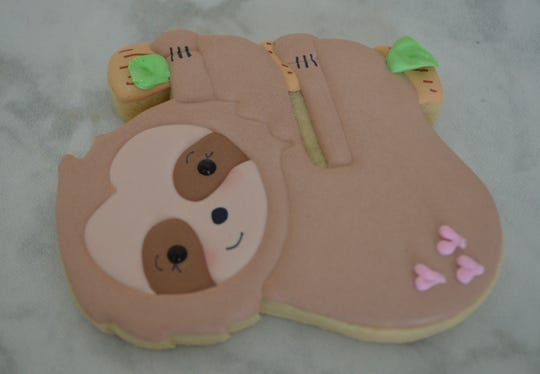 "This sloth cookie goes with the saying, ""I like you slow much."""