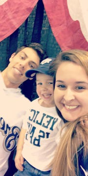 "Milwaukee Brewers MVP Christian Yelich smiles next to his ""BFF"" Carter Gonzalez and his mom Crystal Gonzalez on Jan. 27 at the Brewers on Deck event."