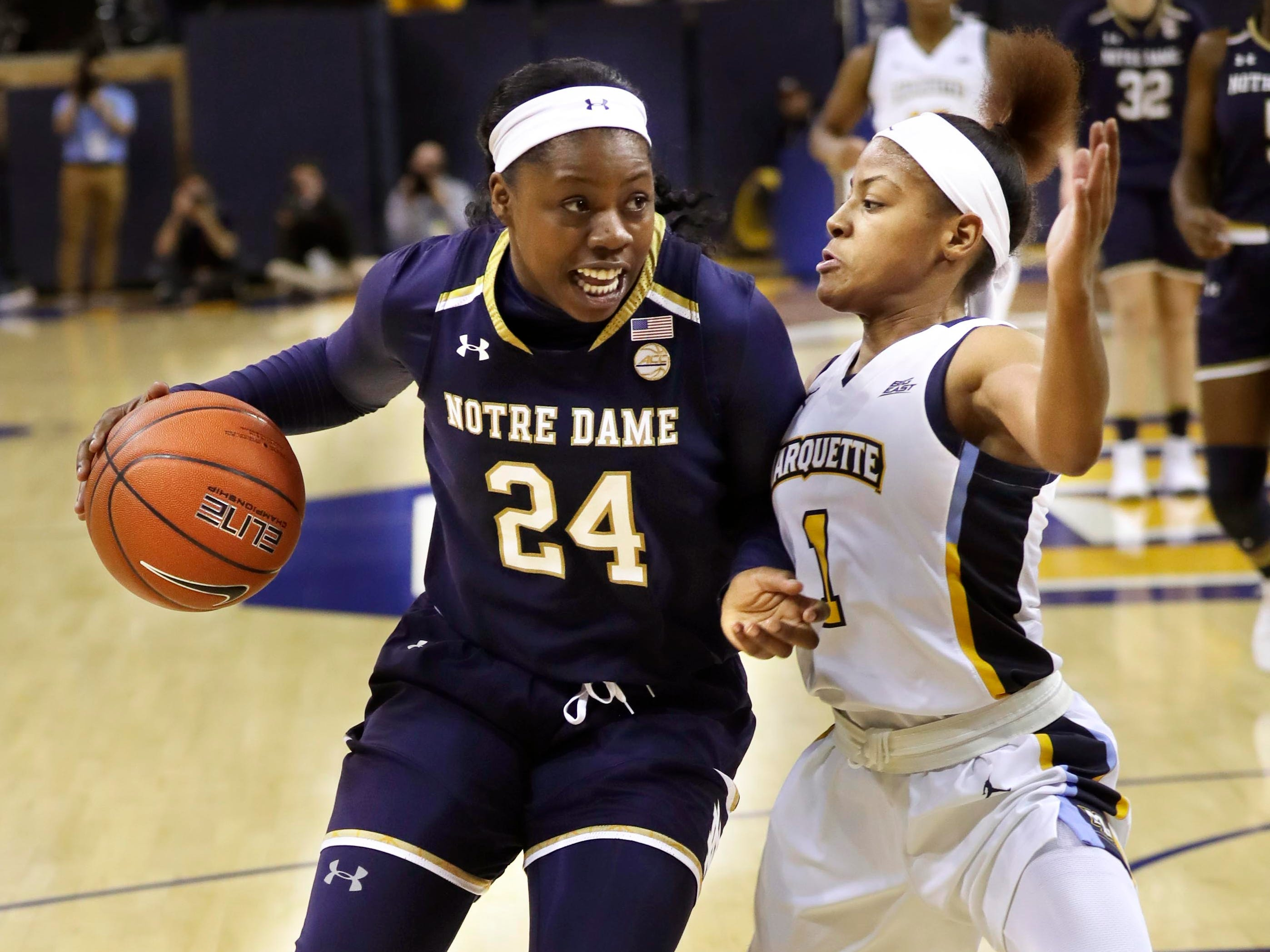 Notre Dame Fighting Irish guard Arike Ogunbowale (24) drives against Marquette Golden Eagles guard Danielle King during a nonconference game Dec. 22 at the Al McGuire Center.