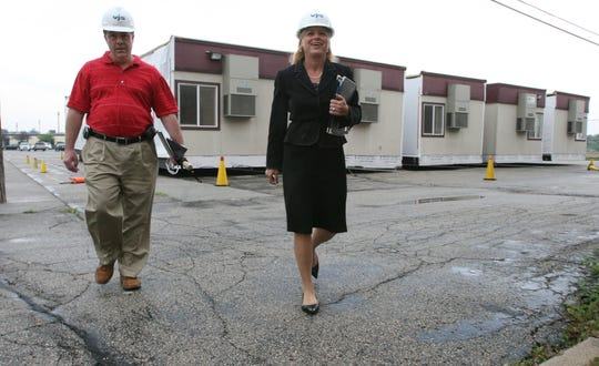 Brown Deer Schools Superintendent Deb Kerr (right) and then District Business Manager Edward Towle (left) walk past  trailer classrooms waiting to be placed for the new school year at the high school in 2007. Towle was placed on administrative leave from the district in 2009. He recently lost an appeal in court accusing the district of breach of contract.