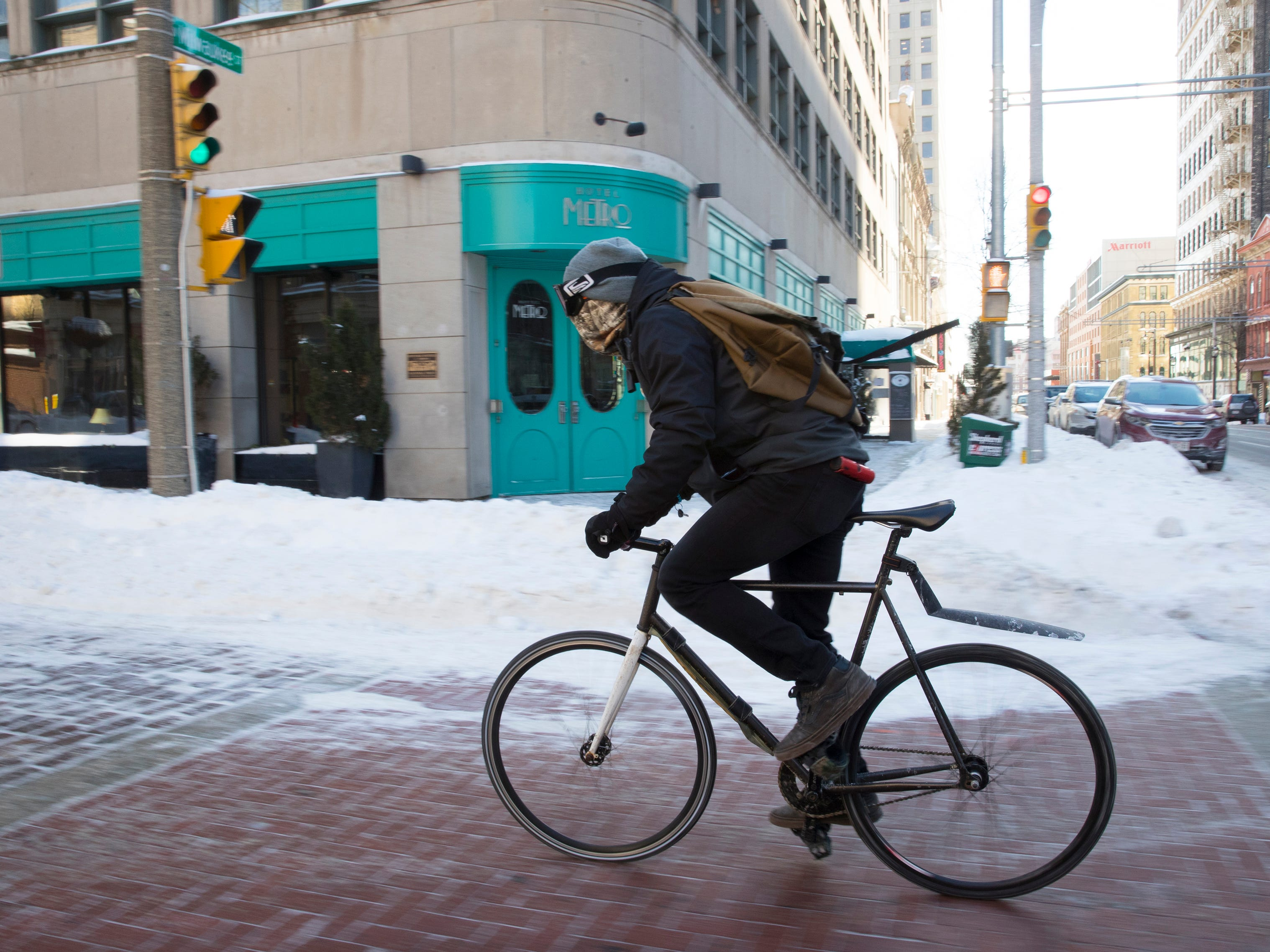 Breakaway Bicycle Courier messenger Corey Wolf was still at work making deliveries despite the frigid weather in downtown Milwaukee, Wis.