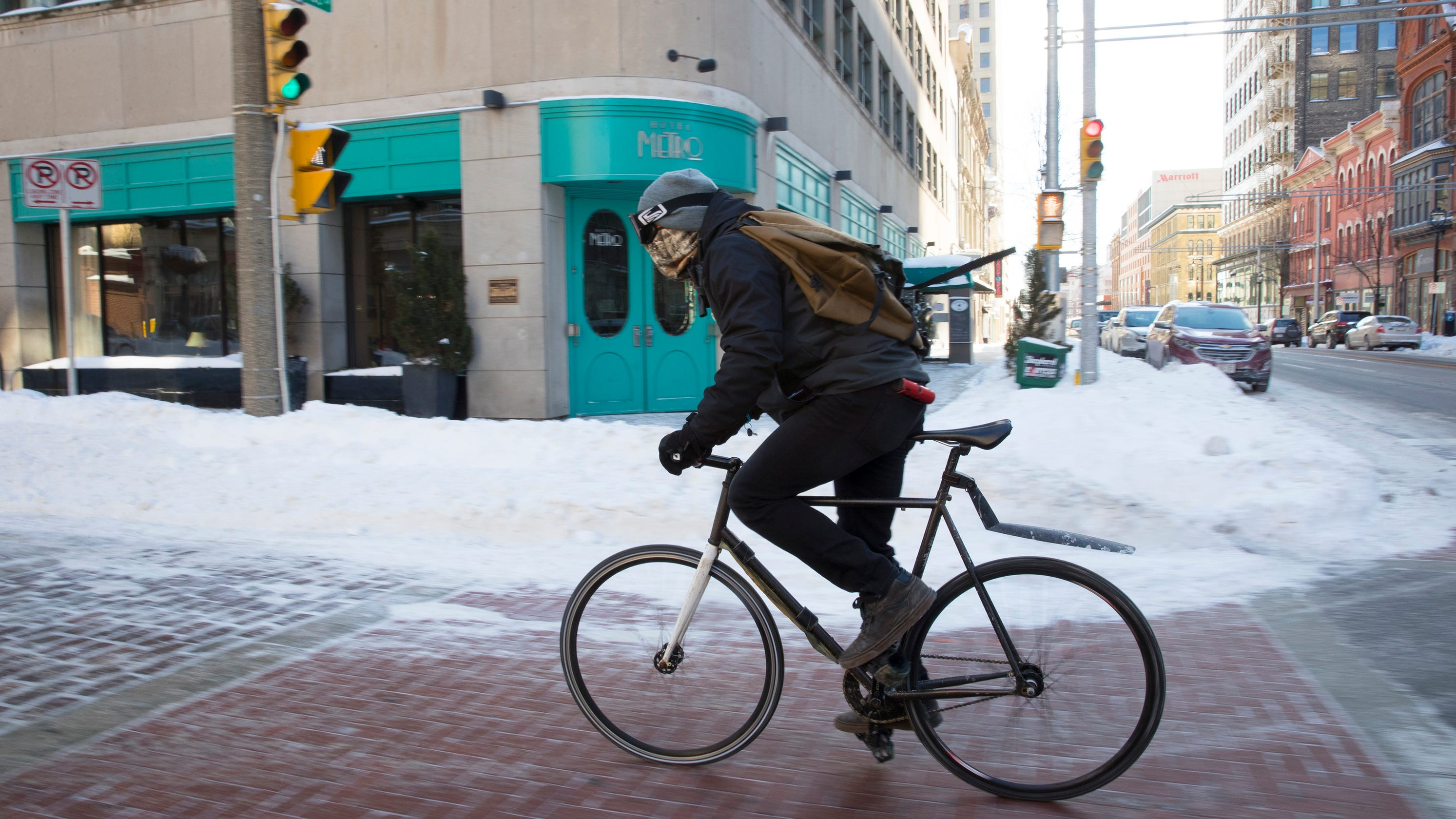 Polar vortex: Some workers continue to brave cold to do
